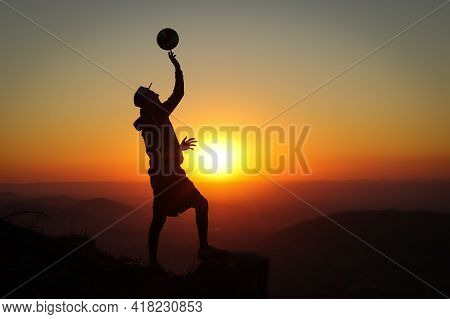 Extra-league Volleyball Player Stands On A Stump At The Top Of A Mountain And Plays With A Volleybal