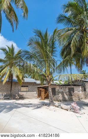 Zanzibar, Tanzania - February 8. 2020: Street View With A House And Palms In The Fishing Village Of