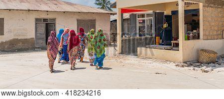 Zanzibar, Tanzania - February 8. 2020: Panorama Of A Group Of Covert Moslem Women At The Street In T