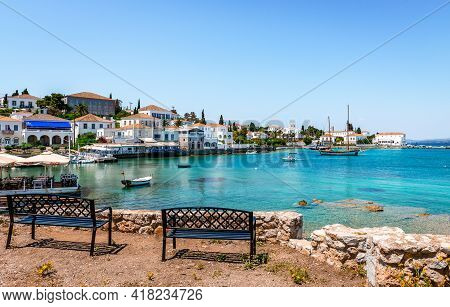 Spetses, Greece - April 28 2018: View Of The Old Harbour With The Town In The Background. Spetses Is