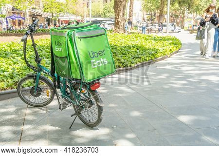 Palma De Mallorca, Spain; April 23 2021: Parked Green Bicycle Of The Uber Eats Company At Plaza De E