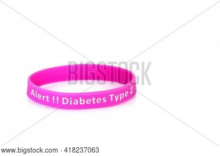 Diabetes type 2 alert wristband in purple rubber silicone on white background.