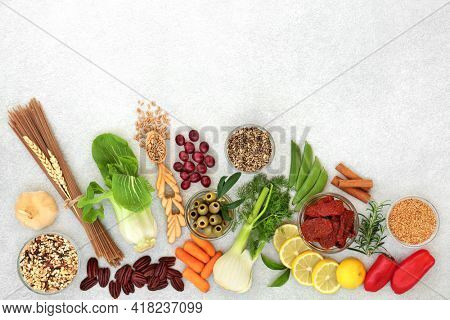 Low cholesterol vegan health food for a healthy heart with omega 3, protein, antioxidants, anthocyanins, vitamins, fibre, lycopene and smart carbs. Health care concept for cardiovascular system.