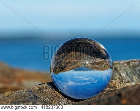 Spectacular Rocky Shore Of Sidney Bc With Beautiful Skies Reflects In The Lens Ball