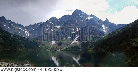 Wide Angle View Of Morskie Oko Naturally Formed Lake Pond In Tatra Mountains In Poland. High Mountai