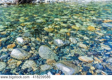 A Close-up Shote Of Clear Water Flowing Over Rocks In Denny Creek In Washington State.
