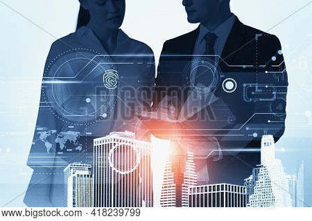 Two Businesspeople Working Together Over Digital Interface And Looking At Book. Concept Of Teamwork,
