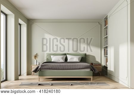 Stylish Bedroom Interior With Bed And Pillows, Parquet Floor And Carpet, Coffee Tables With Decorati