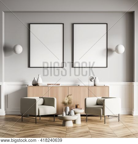 Light Living Room Interior With Two Armchairs And Coffee Table, Wooden Drawer With Books And Decorat