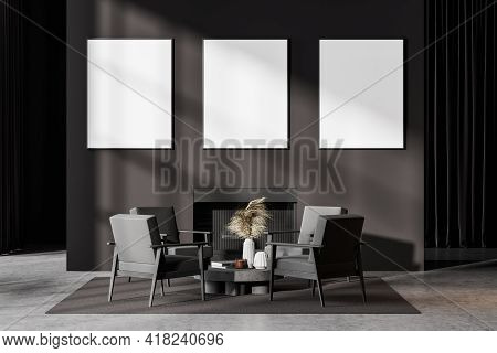 Contemporary Dark Grey Living Room Interior With Fireplace, Armchairs. Three Posters In A Row Templa