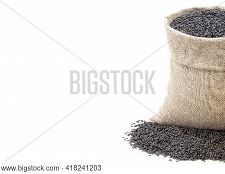 Black Sesame. Black Sesame In A Sack Of Isolated On A White Background.. Black Sesame In A Burlap Sa