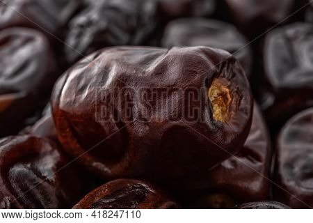 Dried Dates Close-up. Macro Shot Of Delicious Dried Date Fruits. Tasty Vegetarian, Dieting And High-