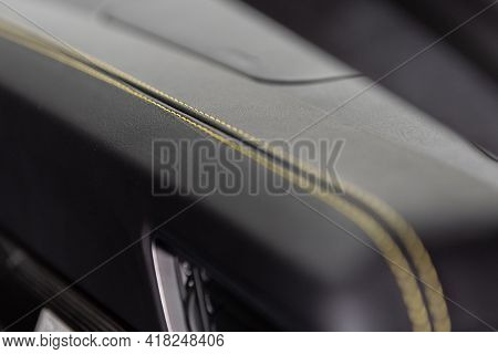 Fine Details On This Car Interior Dashboard With Yellow Stitching On A Double Row On The Seam.