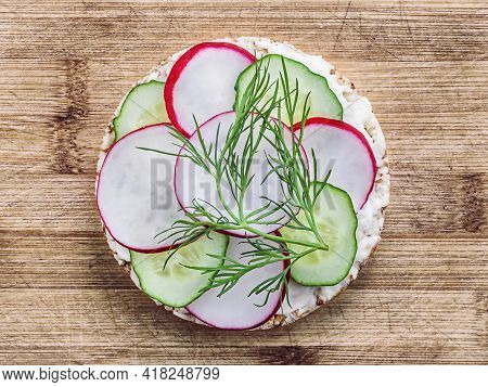 Sandwich Of Diet Bread With Slices Of Radish Cucumber And Melted Cheese On Wooden Cutting Board, The