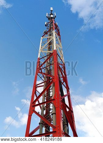 Bottom View Of Telecommunications Tower Under Caribbean Blue Sky. Metallic Structure And Antennas Fo