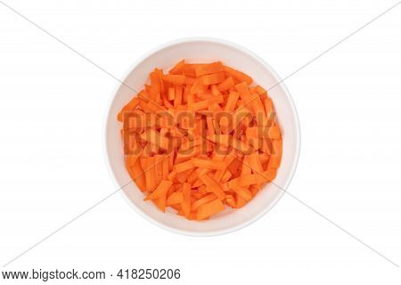 Sliced Carrots In A Plate On A White Background. Fresh Carrots Cut Pieces Close-up.
