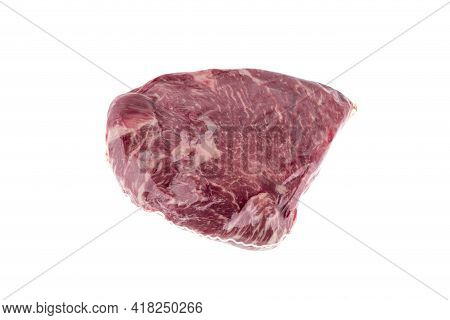 Vacuum Packed Meat On A White Background. Close-up Of Beef In A Vacuum Bag.