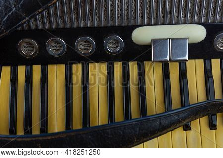 Old Musical Accordion Isolated On Dark Background.
