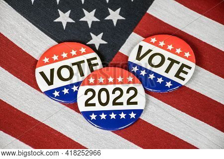 Election Campaign Vote Buttons On American Flag For 2022