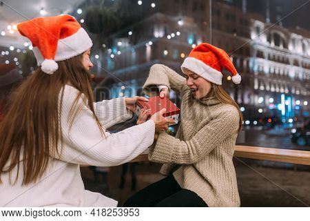 Girls Fight For A Gift At Cafe. Friends Fun In Cafe