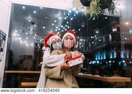 Young Beautiful Women, Give Gift Box In Camera At Cafe.