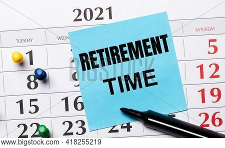 The Calendar Has A Blue Sticker With The Text Retirement Time And A Black Marker. Organizational Con