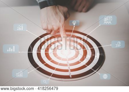 Targeting The New Business Concept, Businessman Use Fingers Touch Dart To Virtual Target Dart Board,