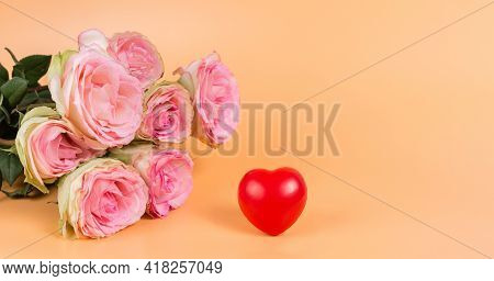 Pink Roses And A Red Heart. A Holiday Card And A Declaration Of Love For A Woman