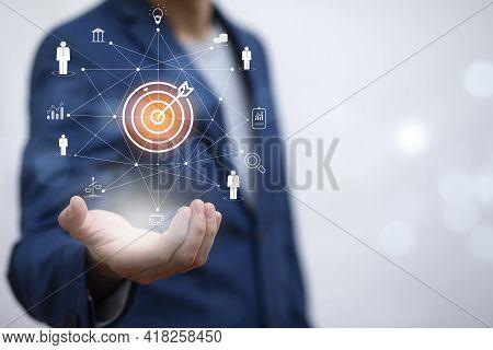 Targeting The Business Concept, Businessman Holding Arrow Dart To Virtual Target Dart Board,executiv