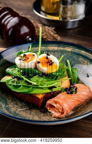 Sandwich With Poached Egg, Herbs And Salmon. Healthy Lunch, Breakfast Or Light Dinner Meal. Healthy