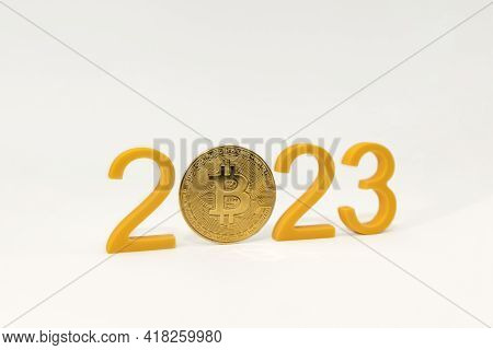 Bitcoin Price Prediction For 2023, Cryptocurrency Value In 2023. Yellow Numbers And Bitcoin Coin On