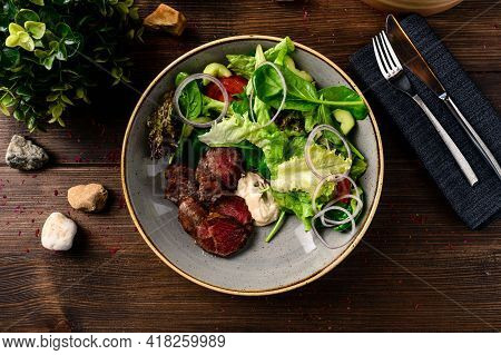 Grilled Steak With Green Lettuce, Cucumber And Fresh Rosemary. Home Made Tasty Food. Concept For A T