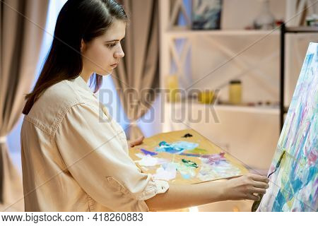 Female Artist. Painting Process. Professional Art Studio. Leisure Hobby. Inspiration Muse. Calm Woma