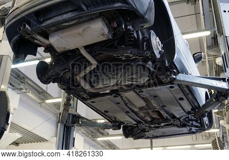 Modern Car In A Car Service. Bottom View. The Underside Of The Car, Suspension And Exhaust System El
