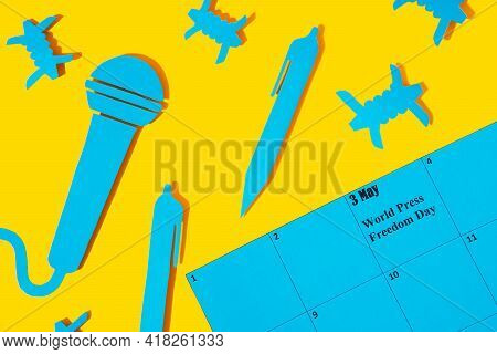 World Press Freedom Day Concept.may 3 On The Calendar.a Blue Microphone And A Pen Made Of Paper, As