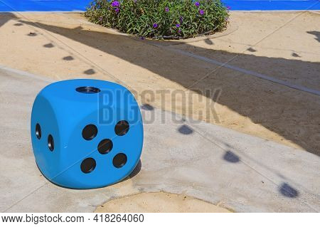 Blue Huge Gambling Cube As A Creative Decision For Urban Furniture. Oversize Giant Blue Dice Shaped
