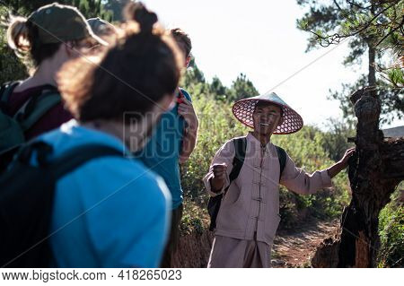 Shan State, Myanmar - January 6 2020: A Burmese Hike Tour Guide In Traditional Clothing Smile While
