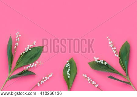 Pink Background With White Delicate Lily Of The Valley Flowers For Mother's Day Card. Modern Minimal