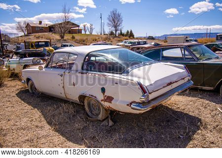Exterior Of A Junked Vintage Retro Vehicle In A Junkyard.