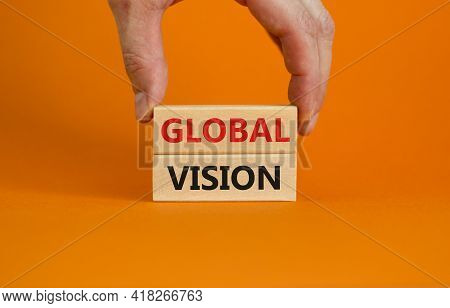 Global Vision Symbol. Wooden Blocks With Words 'global Vision' On Beautiful Orange Background. Busin