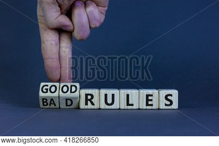 Good Or Bad Rules Symbol. Businessman Turns Wooden Cubes And Changes Words 'bad Rules' To 'good Rule