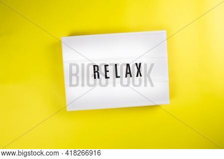 Lightbox With Text Message Relax Isolated On Yellow Background. Concept Of Chill, Coffee Break, Rest