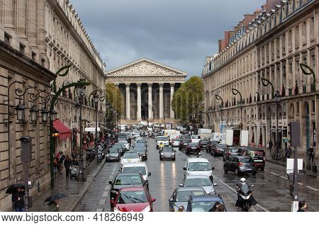 Paris, France, 1.11.2019 - View Of Busy Rainy Royal Street And Madeleine Church, La Rue Royale. Cent