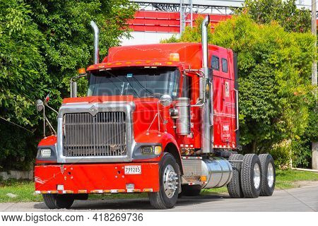 Panama David April 22, Red Semi Tractor-trailer Truck With Chrome Vertical Mufflers. Shoot On April