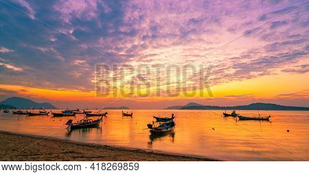 Longtail Boats With Travel Boats In Tropical Sea Beautiful Scenery Morning Sunrise Or Sunset Sky Ove
