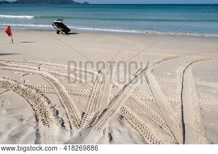 4x4 Tyre Tracks Crisscrossing Tire Tracks On The Sand Texture Background In Summer Day On The Beach