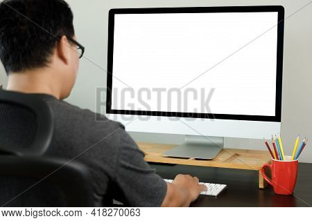 Laptop Or Notebook With Blank Screen Man Work From Home  On Laptop Computer In A Modern Room At Offi