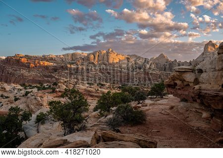 Morning Light Brightens Distant Rocks As Trail Passes To The Right In Capitol Reef National Park