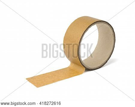 The Coil With The Adhesive Tape Is Isolated On A White Background. Universal Packaging Tape.