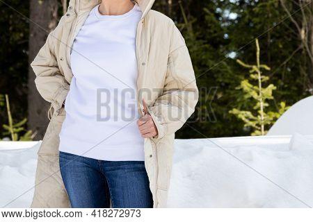 White Sweatshirt Mockup Of A Girl In Beige Quilted  Jacket, Model Mockup